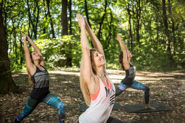 58188828 - fitness group practicing yoga exercises outside